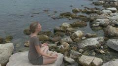 Beautiful woman doing yoga on the beach, female nature  coastline Stock Footage