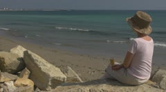 Lady drink white wine beach coastline rock sitting summer leisure nature rock  Stock Footage