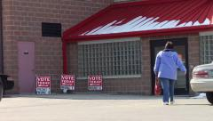 Woman Enters Voting Station Stock Footage
