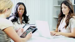 Diverse business management planning future profit shares using tablet  Stock Footage