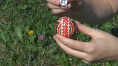 Lady painting Easter egg springtime handicraft decorative decoration traditional Stock Footage