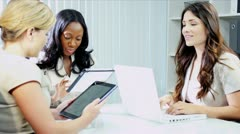 Diverse businesswomen planning funds online tablets in office  - stock footage