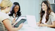 Stock Video Footage of Diverse businesswomen planning funds online tablets in office