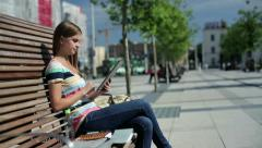 Young woman with tablet computer in the city, steadicam shot HD Stock Footage