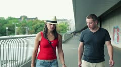 Arguing couple walking on the bridge, stedycam shot Stock Footage