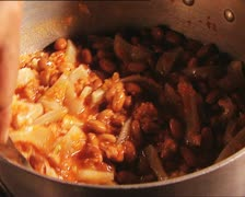 FOOD cooking stirring beans with tomato and pork rind AUDIO Stock Footage