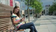 Stock Video Footage of Happy female student with tablet computer in the city, steadicam shot HD