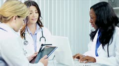 Multi ethnic medical team discussing clinical trials  - stock footage