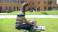 Stock Video Footage of Young student with tablet computer on campus, steadicam shot HD