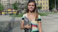 Stock Video Footage of Happy female student walking in the city, steadicam shot HD