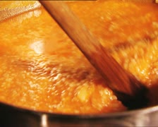 FOOD cooking stirring spelt with tomato soup DET AUDIO Stock Footage