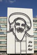 Stock Photo of steel image of castro on building in havana
