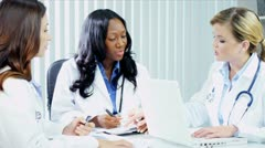 Diverse young female consultants keeping patients records   Stock Footage