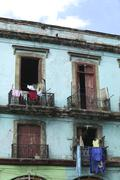 Laundry hanging from old houses in cuba Stock Photos