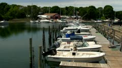 Row of boats docked at pier Stock Footage