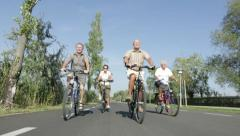seniors biking - stock footage
