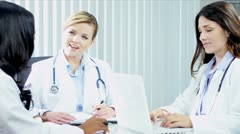 Diverse medical team working hospital budgets using laptop  - stock footage