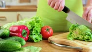 Woman's hands cutting vegetables Stock Footage