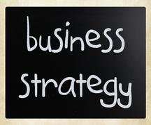 """""""business strategy"""" handwritten with white chalk on a blackboard Stock Photos"""