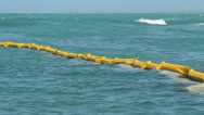 OIL SPILL  contention barrier Stock Footage