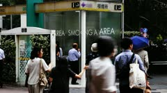 Smoking area around Shibuya subway station in Tokyo Stock Footage