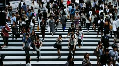 Crowded pedestrian crossing Stock Footage