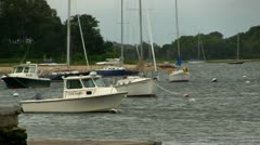 Boats facing upwind in Cape Cod cove Stock Footage