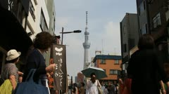 Skytree tower seen at market in Asakusa, Tokyo Stock Footage
