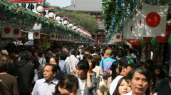 Crowd at traditional Japanese market in Asakusa, Tokyo - stock footage