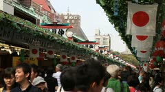 Crowds at traditional Japanese market in Asakusa, Tokyo Stock Footage