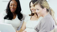 Diverse girlfriends talking and chilling online on laptop  - stock footage