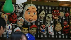 Traditional Japanese souvenir - masks Stock Footage