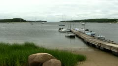 Docked dinghies in Cape Cod cove Stock Footage