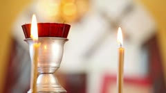 candles in the Christian church, in the focus, on the background of icons - stock footage