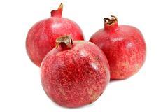 Ripe pomegranates isolated on white background Stock Photos
