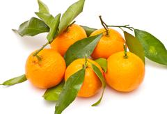 ripe tangerines on white background - stock photo