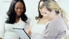 Multi ethnic girlfriends chatting online tablet computer   - stock footage