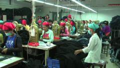 Asian Garment Industry Factory: WS Slow Pan Workers Stock Footage