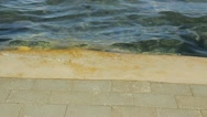 Sea water over dike Stock Footage