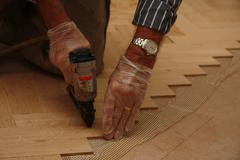 laying wooden parquety flooring - stock photo