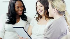 Diverse pretty women socializing using tablet computer  - stock footage