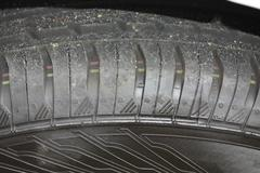 new car tire detail - stock photo