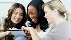 Multi ethnic girlfriends have fun online socializing with tablet   Stock Footage