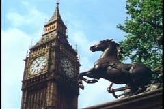 Big Ben, London, England, medium close up, bronze horse in foreground - stock footage