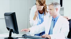 Caucasian Hospital Medical Consultants Working with Computer  Stock Footage