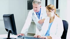 Caucasian Medical Colleagues Meeting on Patient Information  - stock footage
