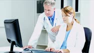Caucasian Medical Colleagues Meeting on Patient Information  Stock Footage