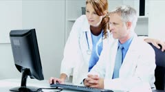 Caucasian Hospital Doctors Accessing Patient Information  Stock Footage