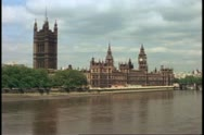 Stock Video Footage of Houses of Parliament, London, England, wide shot, front view with Thames