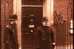10 Downing Street, Lord Chamberlain and wife emerging from taxi, archival Stock Footage